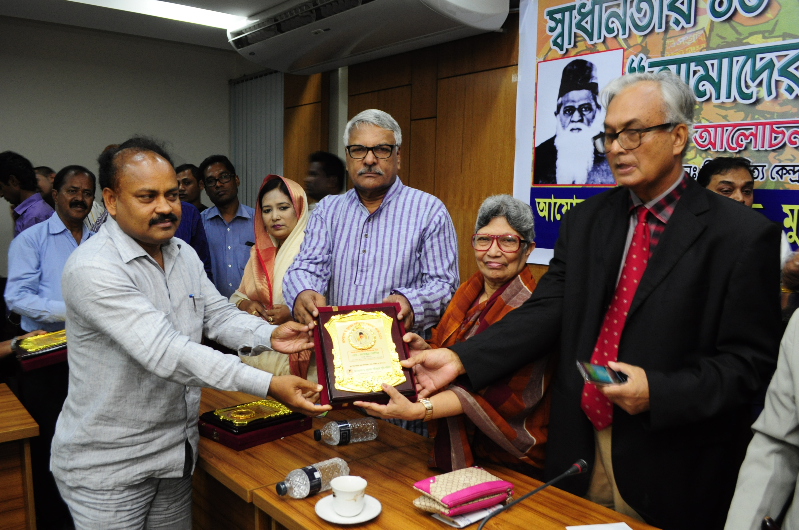 M. Manjur Kadir, ED SMKK is receiving DR. Mohammad Shahidullah award